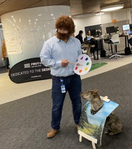 scott and his dog dressed as bob ross and a painting