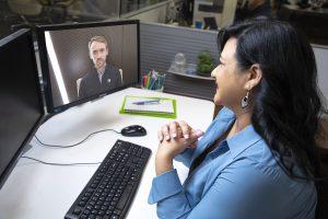woman and man in skype meeting