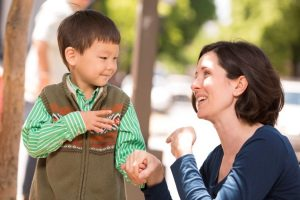 woman and child using sign language