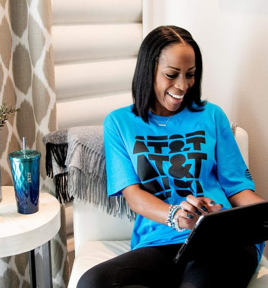 AT&T employee wearing AT&T branded shirt while holding an iPad